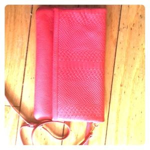 Foldover embossed python design clutch in Coral